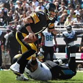 Steelers quarterback Ben Roethlisberger tries to break away from the Jaguars defense Sunday at EverBank Field.