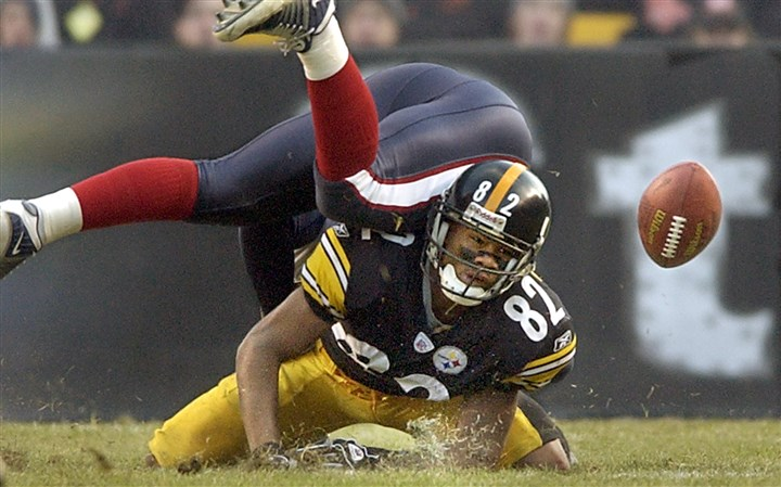 badcutbig1005-3 Antwaan Randle El loses ball while being hit during a punt return against the Houston Texans in 2002.