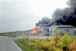 A fire burns Friday in the Flight 93 National Memorial headquarters in Stonycreek Township, Somerset County.