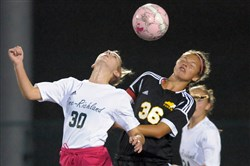 Pine-Richland's Jennifer Shulkosky, left, and North Allegheny's Amanda Miller both strive to gain possession during a recent Section 2-AAA match.