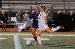 Franklin Regional's Haley Zeliff clears the ball as Plum's Alexandra Gipson defends.