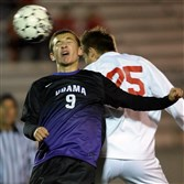 Obama Academy's Theodore Papazekos heads the ball against West Allegheny's Michael Roberts Tuesday night.