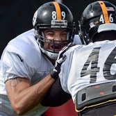Matt Spaeth works with Will Johnson during a Steelers practice on the South Side Wednesday afternoon, October 8, 2014