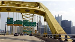 Drivers and passengers get a spectacular view of Pittsburgh as they enter the Fort Pitt Bridge toward Downtown, Pittsburgh.  The bridge opened in June 1959.