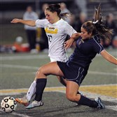 Penn-Trafford's Natalie DiPaolo, left, gets her toe on the ball battling Norwin's Taylor Curpie, right, at mid-field in the first half Wednesday at Penn-Trafford.