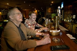"In this 2005 file photo, Dwight and Mary Brown of Shadyside watch ""Jeopardy"" at the bar of The Elbow Room, Shadyside."