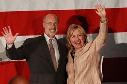 Democratic gubernatorial candidate Tom Wolf and former Secretary of State Hillary Clinton wave to the crowd after Mr. Wolf introduced her to the crowd at the Constitution Center in Philadelphia on Thursday.