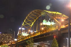 A  night view of the Fort Pitt Bridge.