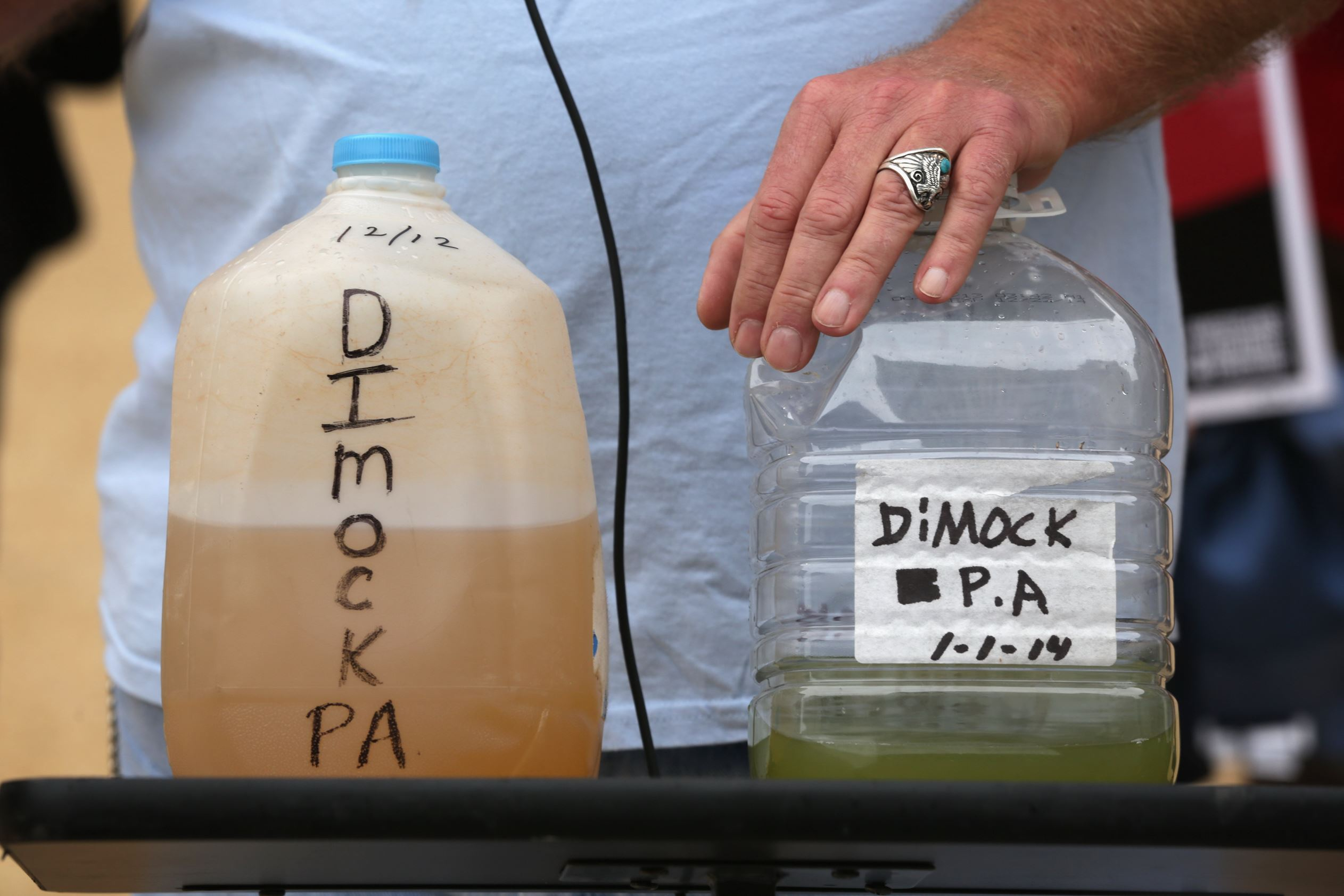 PAfracking2 Ray Kemble show water samples collected from Dimock during a 2014 rally on fracking-related water investigations outside EPA's Headquarters in Washington, D.C.