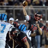West Allegheny's Andrew Koester passes against Woodland Hills at Joe P. Demichela Stadium Friday night.