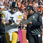 Steelers quarterback Ben Roethlisberger talks with offensive coordinator Todd Haley as they face the Browns on Sunday in FirstEnergy Stadium in Cleveland.