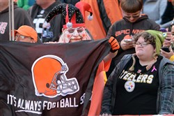 A Browns fan celebrates at the two-minute warning of Cleveland's win over the Steelers on Sunday.