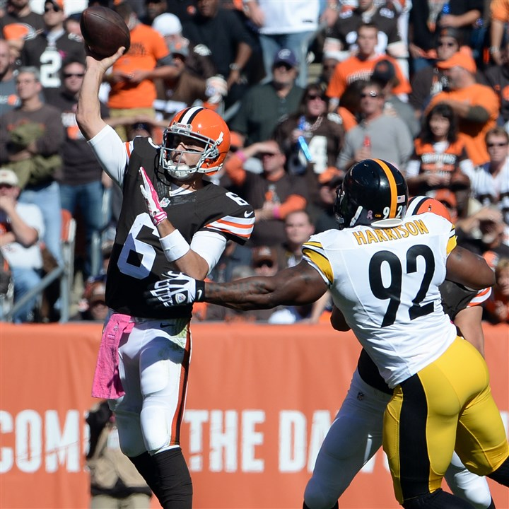 20141012mfsteelerssports06-1 Browns quarterback Brian Hoyer throws a touchdown pass to Jordan Cameron as he's defended by Steelers' James Harrison in the second quarter at FirstEnergy Stadium in Cleveland Sunday afternoon, October 12, 2014.