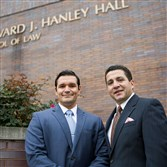 Duquesne University Law Student, Jorge Rojas, left, and Ron Alvarado, Pittsburgh Metropolitan Chamber of Commerce chairman, stand at a campus facility on Locust Street.