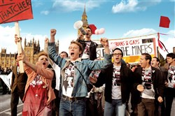 "(Front row, left to right) Faye Marsay as Steph, George Mackay as Joe, Joseph Gilgun as Mike, Paddy Considine as Dai and (second row, with megaphone) Ben Schnetzer as Mark in ""Pride.""  Photo credit: Nicola Dove"