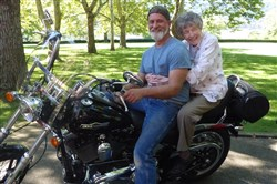 Sister Mildred Boeh rode on the back of Dave Lubonovich's motorcycle around the Sisters of St. Joseph motherhouse in Baden to celebrate her 101st birthday.