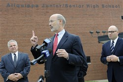 Democratic gubernatorial candidate Tom Wolf, joined by Aliquippa School District Superintendent David Wytiaz, Aliquippa Mayor Dwan Walker and state Rep. Rob Matzie, D-Beaver, speaks on education funding at Aliquippa High School this afternoon.