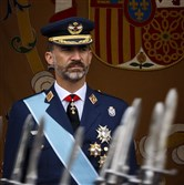 King Felipe VI watches a military parade on Spain's National Day Sunday.