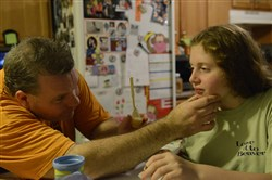 Joe McGurk checks to make sure that Leah has swallowed her vitamin pill before giving her other medications. Leah has Dravet syndrome, a rare form of epilepsy. To get her brain to stop seizures, Leah takes six medications a day.