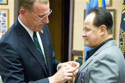 U.S. Rep. Tim Murphy pins the Purple Heart on Carl Charnesky's chest.