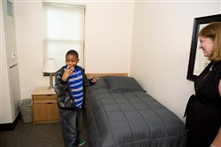 Fifth-grader Maleek Washington shows his dorm room to a guest at the Western Pennsylvania School for Deaf in Edgewood on Wednesday.