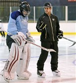 Penguins backup goaltender Thomas Greiss talks with Tristan Bolyard during a Steel City Icebergs practice at the Robert Morris University Island Sports Center.