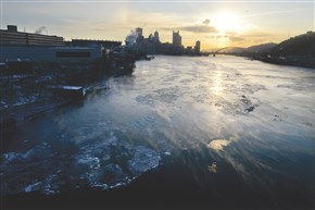 Steam blows across a thin layer of ice last January on the Ohio River. Last winter's historic cold has brought a new sense of urgency to predictions.