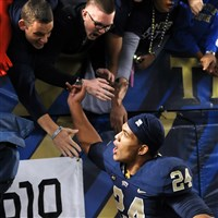 Pitt's James Conner is congratulated by the student section after defeating Virginia Tech at Heinz Field Thursday night, October 16, 2014.