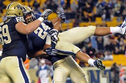 Pitt wide receiver James Conner is hoisted by teammate Manasseh Garner after running for a touchdown against Virginia Tech in the fourth quarter at Heinz Field.