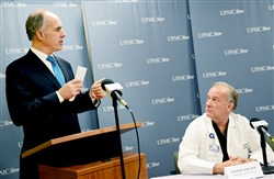 Sen. Bob Casey, D-Pa., speaks at a news conference at UPMC Presbyterian about funding for the Hospital Preparedness Program and the region's preparedness for an infectious outbreak as Donald Yealy, UPMC chair of emergency medicine, listens.