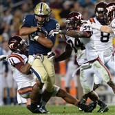 Pitt's James Conner carries for a first down as Virginia Tech's Kendall Fuller tries to take him down in the fourth quarter at Heinz Field Thursday night, October 16, 2014.