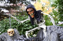 Ghouls lurk in the front yard of Chris Palmer 's Regent Square home.