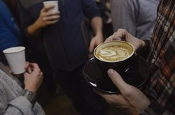 After the judges scored the latte art in the first Latte Art Throwdown during Pittsburgh Coffee Week, the aficionados in what was Voluto Coffee and is now Commonplace Coffee, compared the cups.