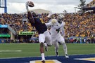 West Virginia's Kevin White pulls in a pass for a touchdown against Baylor's Xavien Howard during an October game.
