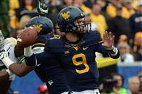 West Virginia quarterback Clint Trickett drops back to pass against Baylor in the first quarter at Milan Puskar Stadium in Morgantown Saturday afternoon.