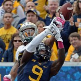West Virginia's K.J. Dillon breaks up a pass intended for Baylor's Levi Norwood in the second quarter at Milan Puskar Stadium in Morgantown Saturday afternoon.