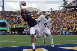 West Virginia's Kevin White pulls in a pass for a touchdown against Baylor's Xavien Howard in the fourth quarter at Milan Puskar Stadium in Morgantown Saturday afternoon, October 18, 2014.
