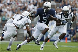 Penn State wide receiver DaeSean Hamilton runs between Akron safety Devonte Morgan and cornerback Bryce Cheek  after taking a pass from quarterback Christian Hackenberg for a first down during the first quarter of an NCAA college football game in State College, Pa., Saturday, Sept. 6, 2014.