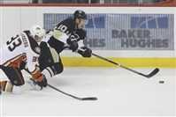 Christian Ehrhoff tries to maintain control of the puck as the Anaheim Ducks' Jakob Silfverberg defends in the first period of the Penguins season opener on Thursday, Oct. 9, 2014 in Pittsburgh.