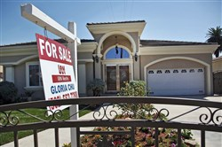 "A  ""For Sale"" sign is posted on a home in Monterey Park, Calif. last month."