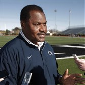 Former Penn State co-defensive coordinator Larry Johnson  speaks to reporters before a practice, Friday, Dec. 30, 2011, in Dallas in anticipation of the TicketCity Bowl.