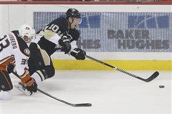 The Penguins' Christian Ehrhoff tries to maintain control of the puck as Anaheim's Jakob Silfverberg defends during a game on Thursday, Oct. 9, 2014 in Pittsburgh.