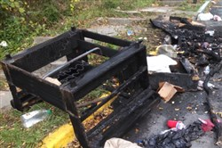 A charred piece of furniture shows part of the damage left behind in some of Morgantown, W.Va.'s streets during Saturday's riots at WVU.