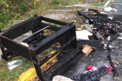 A charred piece of furniture was a small part of the damage left behind that had been burned during Saturday's riots at WVU.