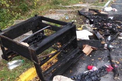 burned_couch.jpg A charred piece of furniture was a small part of the damage left behind that had been burned during Saturday's riots at WVU.