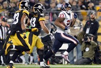 Texans running back Arian Foster carries as he's defended by Steelers safety Mike Mitchell and Troy Polamalu in the first quarter at Heinz Field Monday night.