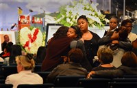 Family and friends comfort one another at the funeral of Omar Hodges today at Covenant Church of Pittsburgh in Wilkinsburg. Mr. Hodges was shot and killed Oct. 13 in Carrick.