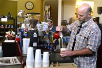 Owner Andy Theobald makes a chai latte at Anchor & Anvil Coffee in Ben Avon.