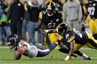 The Texans' DeAndre Hopkins fumbles the ball against the Steelers' Cortez Allen and Sean Spence in the fourth quarter Monday night at Heinz Field. Troy Polamalu recovered the fumble.