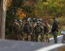 FBI agents prepare to patrol the woods in Swiftwater in northeastern Pennsylvania Saturday during a massive manhunt for suspect Eric Frein.